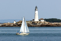 Boston Light with sailboat